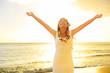 Happy carefree woman free in Hawaii beach sunset