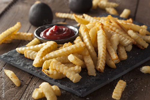 Fototapeta  Unhealthy Baked Crinkle French Fries