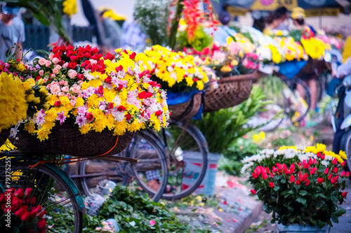 Flower bicycle at small market for florist vendor in Hanoi, Vietnam