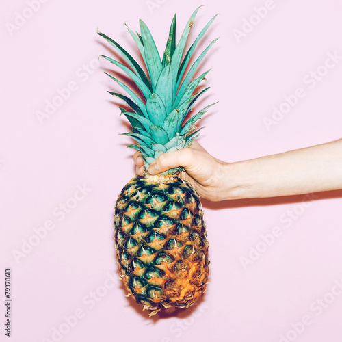 pineapple in hand. Fashion minimal design style Wall mural