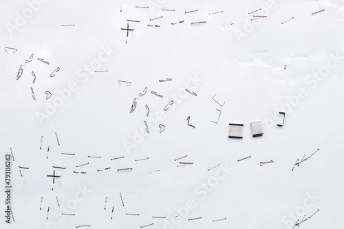 Fotografie, Obraz  White piece of paper with staple needles.