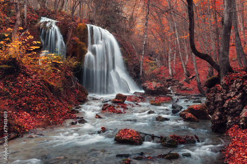 Poster Bordeaux Beautiful waterfall in autumn forest
