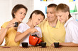 Family drinking tea
