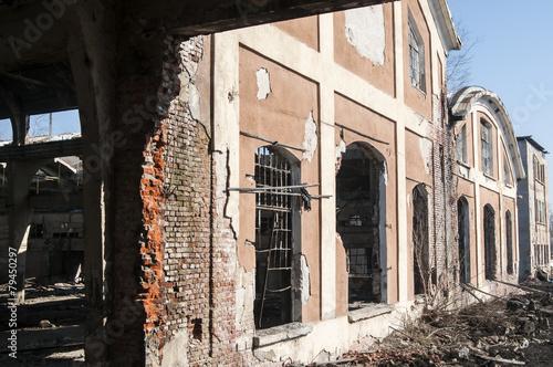 Demolished ruins of facade of old railway factory