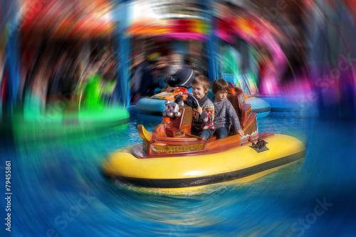 Papiers peints Attraction parc Two boys, riding boat in amusement park