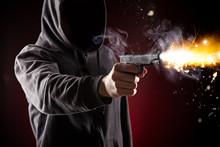 Killer With Gun Close-up