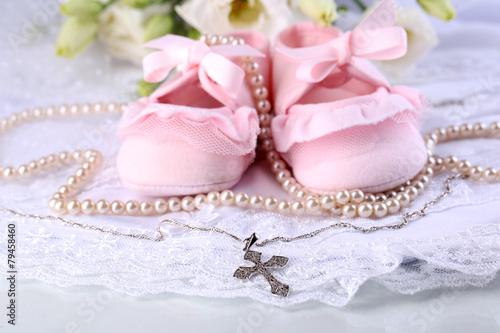 Fotografie, Obraz Baby shoe, flowers and cross for Christening