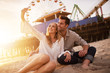 happy romantic couple taking selfie at santa monica