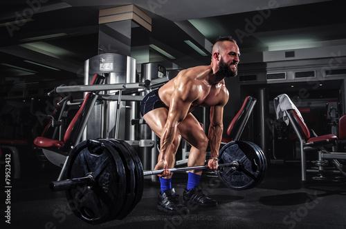 Muscular Man Doing Heavy De...