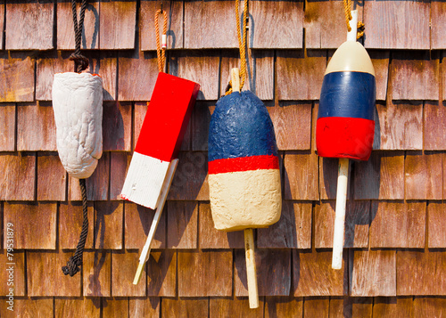 Red white and blue vintage fishing buoys on wood shingles Canvas Print