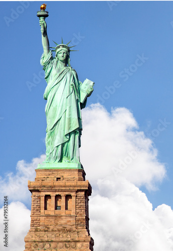 Fotografie, Obraz  Statue of Liberty against blue sky and dramatic clouds
