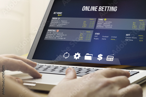 betting online on a laptop Wallpaper Mural