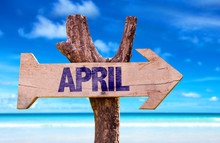 April Wooden Sign With Beach Background