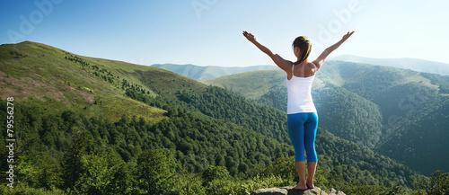 Fototapeta Young woman meditate on the top of mountain obraz