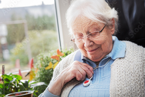 Elderly person with emergency button Canvas Print