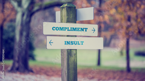 Fotografía  Words Compliment and Insult in a conceptual image