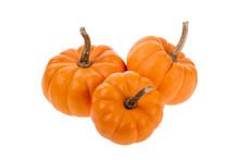 Three Small Orange Pumpkins Isolated On White