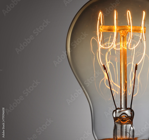 Photo  Close up glowing vintage light bulb