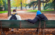 Two People Sitting On The Bench
