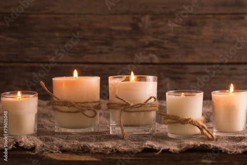 Photo scented candles on old wooden background