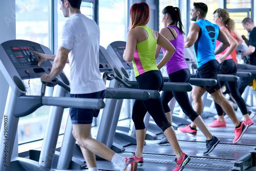 Deurstickers Fitness Group of people running on treadmills