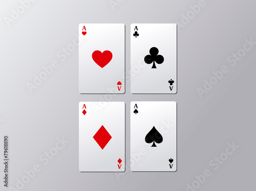 Photo  Playing poker cards. Poker aces flying isolated on gray