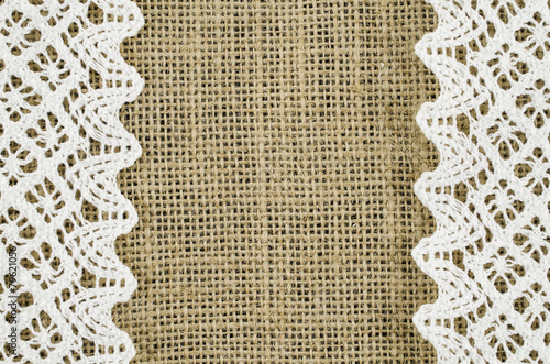 Frame of white napkin on linen background