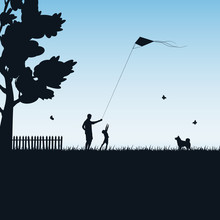 Father And Child Play With Kite