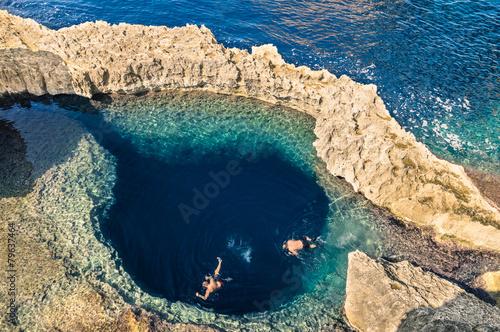 Tuinposter Koraalriffen Deep blue hole at the world famous Azure Window in Gozo Malta