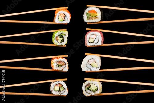 Sushi pieces in chopsticks