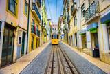 City streetwith yellow funicular, Lisbon, Portugal