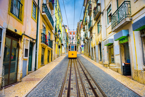 Photo City street with yellow funicular, Lisbon, Portugal