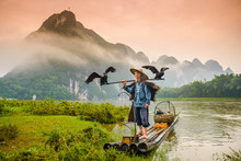 Cormorant FIsherman In Guilin, China On The Li River.