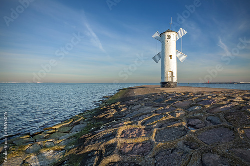 Fotoposter Molens Sunrise on the coast, lighthouse windmill in Swinoujscie, Poland