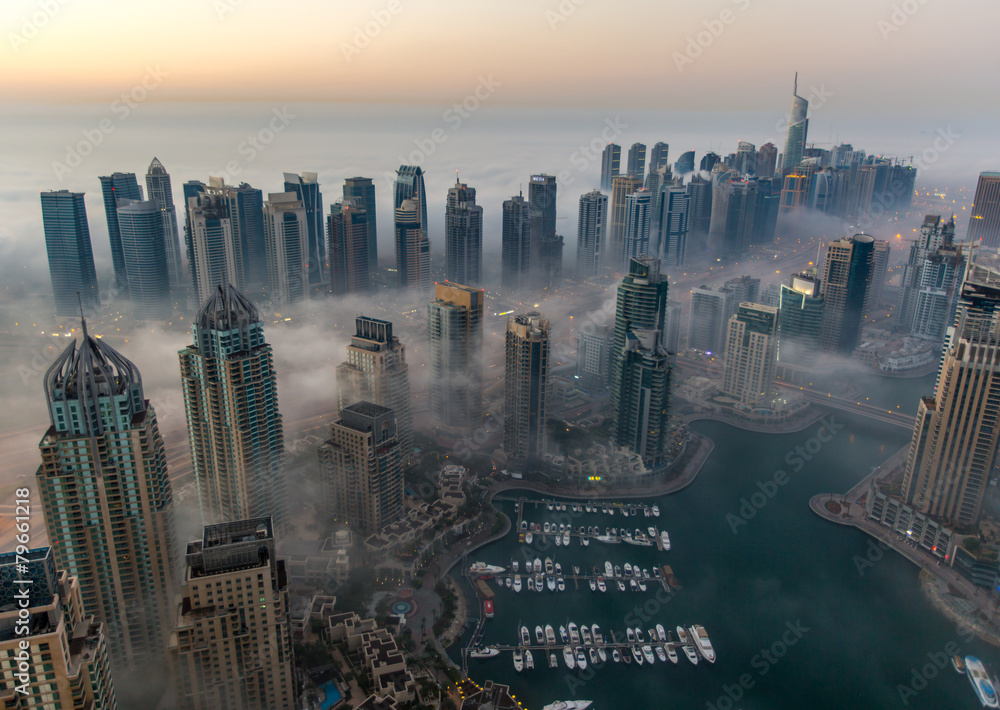 Fototapeta sunrise aerial view skyscraper foggy weather Dubai Marina