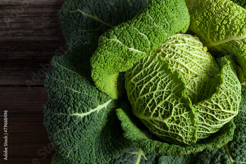 Valokuvatapetti Savoy cabbage superfood closeup on dark wooden backround