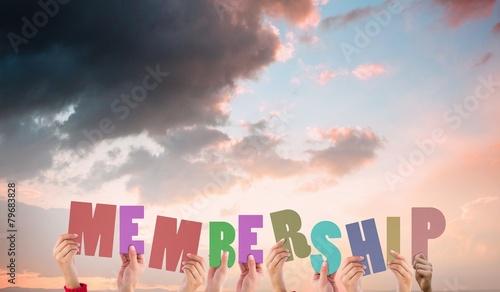 Fotografía  Composite image of hands holding up membership