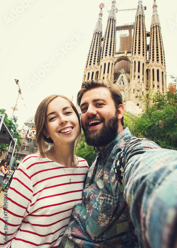 Papiers peints Barcelona Happy couple takes selfie while travel in Barcelona, Spain