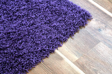 Purple Shaggy Carpet On Brown ...