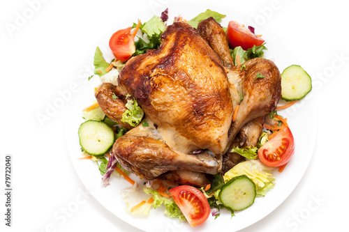 Poster Fleur Appetizing crispy red roasted spicy grilled chicken with vegetable garnish on white plate on isolated white background
