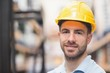 Close up of worker wearing hard hat in warehouse