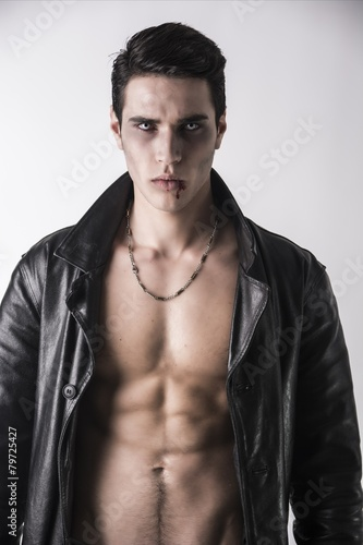 Photo  Young Vampire Man in an Open Black Leather Jacket, Showing his