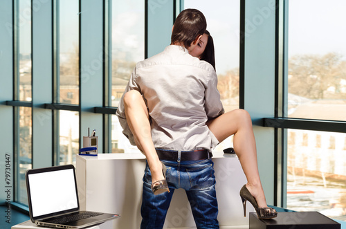 Photo  The concept of sexual relations on work