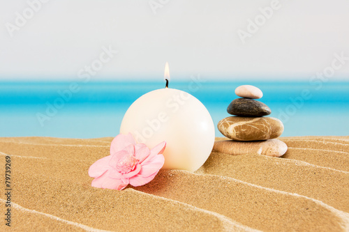 Tuinposter Stenen in het Zand Candle on the beach, relaxation concept