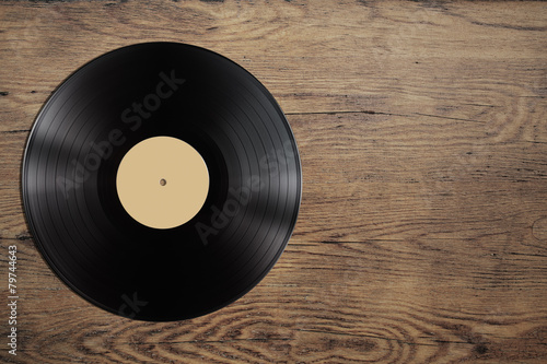 vynil record disc on wooden table Fototapet