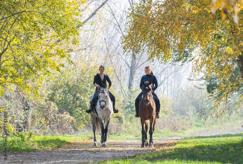 Poster Equitation Girls riding a horse
