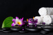 spa concept of purple orchid dendrobium, leaf with dew, towels,