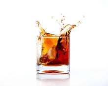 Splash Of Cola In Glass Isolat...