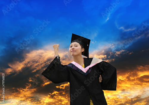1e21f524d446 Beautiful female graduate wearing a graduation gown - Buy this stock ...