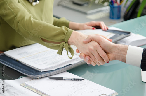 Fotografia  Hand for a handshake. The conclusion of the transaction.